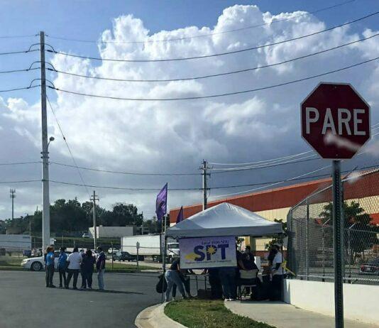 Imagen de trabajadorxs en manifestación con banner del SPT